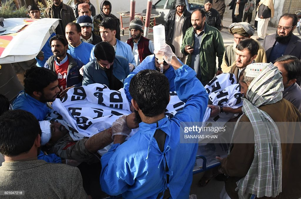 Pakistani paramedics shift an injured Frontier Corps member into a hospital after a bomb explosion in Quetta on December 12 2015 A frontier corps...