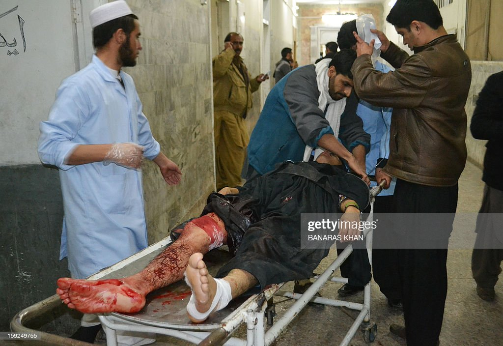 Pakistani paramedics treat an injured blast victim at a hospital following a bomb attack in Quetta on January 10, 2013. At least 57 people were killed in the southwestern city of Quetta as two successive bombs exploded, with one bomb blast occurring outside a snooker club hours after another blast had already left many casualties, police said.