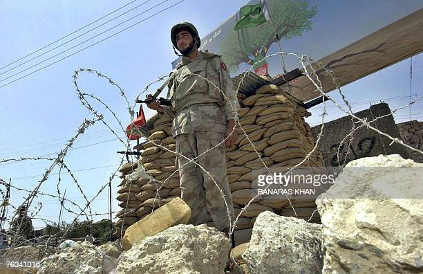 A Pakistani paramilitary soldier stands guard alongside a bunker during a strike in Quetta 26 August 2007 on the first death anniversary of...