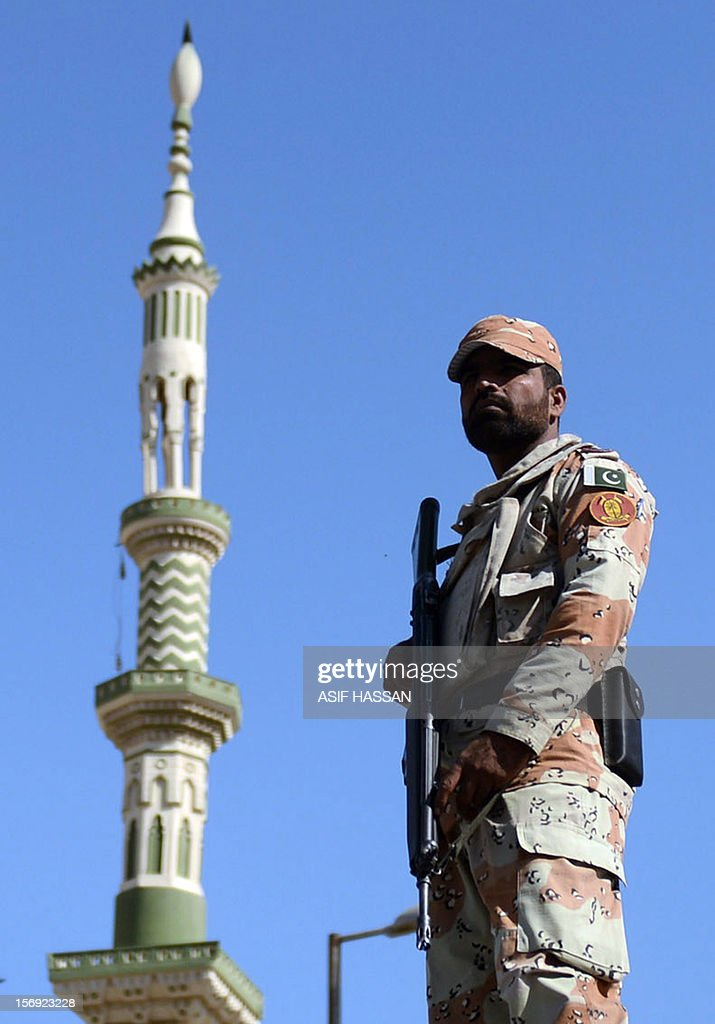 A Pakistani paramilitary soldier stands guard during an Ashura procession in Karachi on November 25, 2012. A bomb attack on a Shiite Muslim procession killed five mourners and wounded more than 80 in northwest Pakistan on November 25 as Shiites marked their holiest day Ashura, officials said. AFP PHOTO/Asif HASSAN