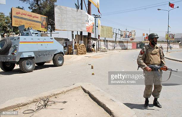 A Pakistani paramilitary soldier stands guard on a street in Quetta on August 26 2008 on the second anniversary of the killing of tribal chieftain...