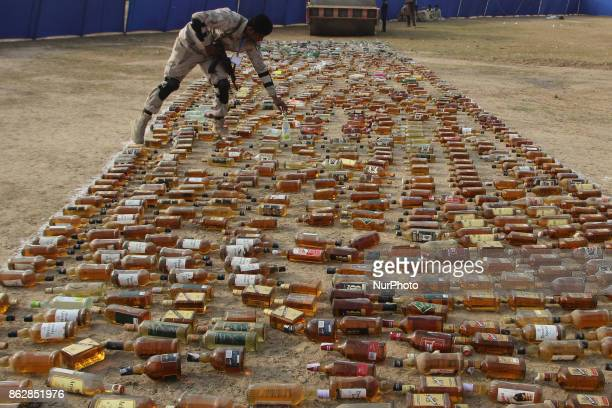 Pakistani paramilitary soldiers antinarcotics force checking the liquor bottles before crushing and burning the seized drugs As Pakistani authorities...