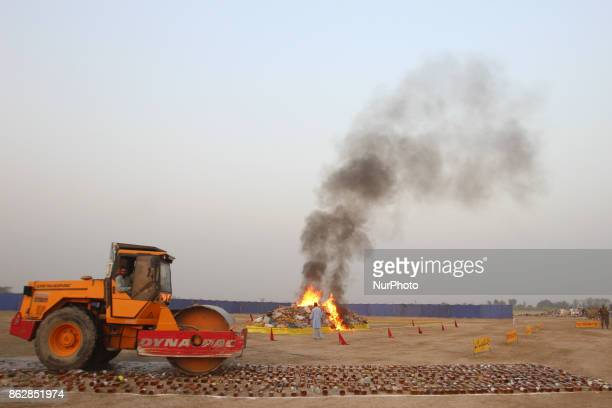 Pakistani paramilitary soldiers antinarcotics force liquor crushing and burning the seized drugs As Pakistani authorities torched tonnes of seized...