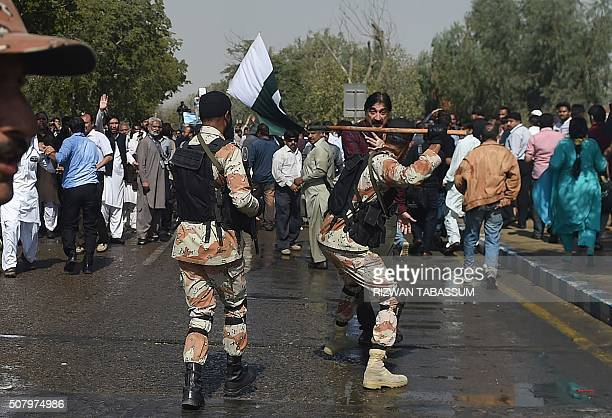 Pakistani paramilitary soldiers baton charge on employees of Pakistan International Airlines during a protest near Karachi International Airport in...