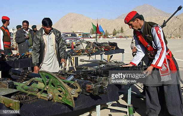 Pakistani paramilitary soldiers display seized weapons and ammunition to media representatives in Quetta on December 22 2010 Pakistani security...