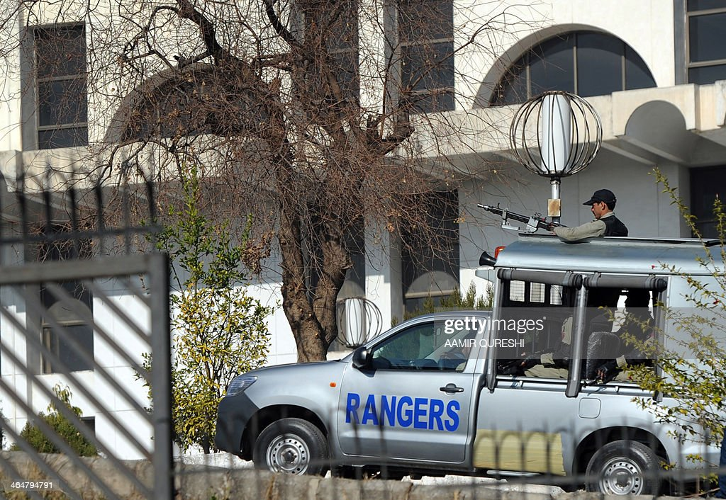 Pakistani paramilitary soldiers patrol at a special court premises set up to try former Pakistani military ruler Pervez Musharraf in Islamabad on January 24, 2014. Pakistan's former military ruler Pervez Musharraf wants to travel abroad for heart surgery requiring special equipment not available at home, legal sources said quoting from a new medical report. Musharraf faces treason charges dating back to his 1999-2008 rule but has not shown up for any hearings of a special tribunal due to security fears and lately a heart complaint. AFP PHOTO/Aamir QURESHI