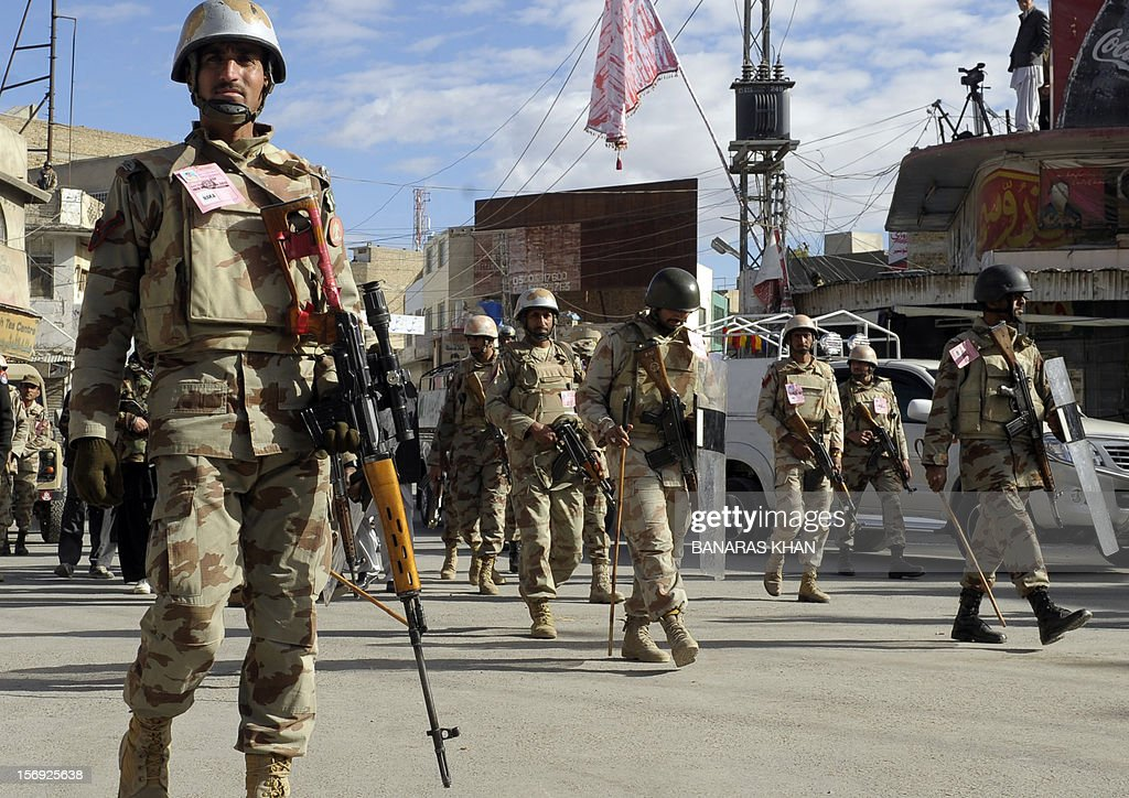 Pakistani paramilitary soldiers patrol on a street during an Ashura procession in Quetta on November 25, 2012. A bomb attack on a Shiite Muslim procession killed five mourners and wounded more than 80 in northwest Pakistan on November 25 as Shiites marked their holiest day Ashura, officials said.