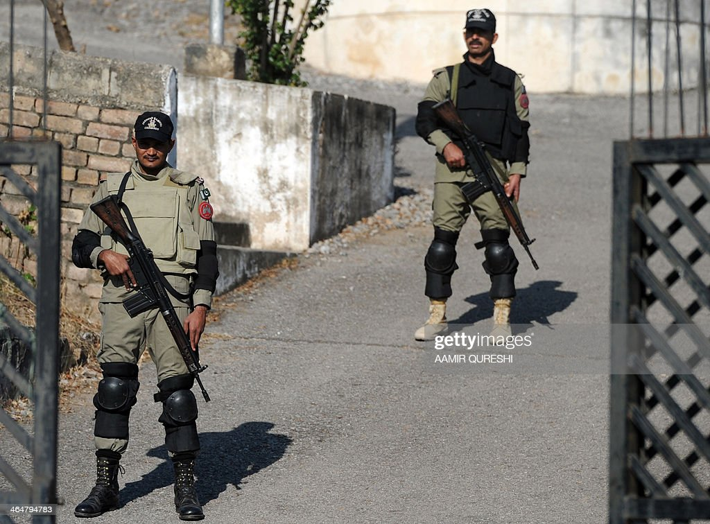 Pakistani paramilitary soldiers stand guard at a special court set up to try former Pakistani military ruler Pervez Musharraf in Islamabad on January 24, 2014. Pakistan's former military ruler Pervez Musharraf wants to travel abroad for heart surgery requiring special equipment not available at home, legal sources said quoting from a new medical report. Musharraf faces treason charges dating back to his 1999-2008 rule but has not shown up for any hearings of a special tribunal due to security fears and lately a heart complaint. AFP PHOTO/Aamir QURESHI