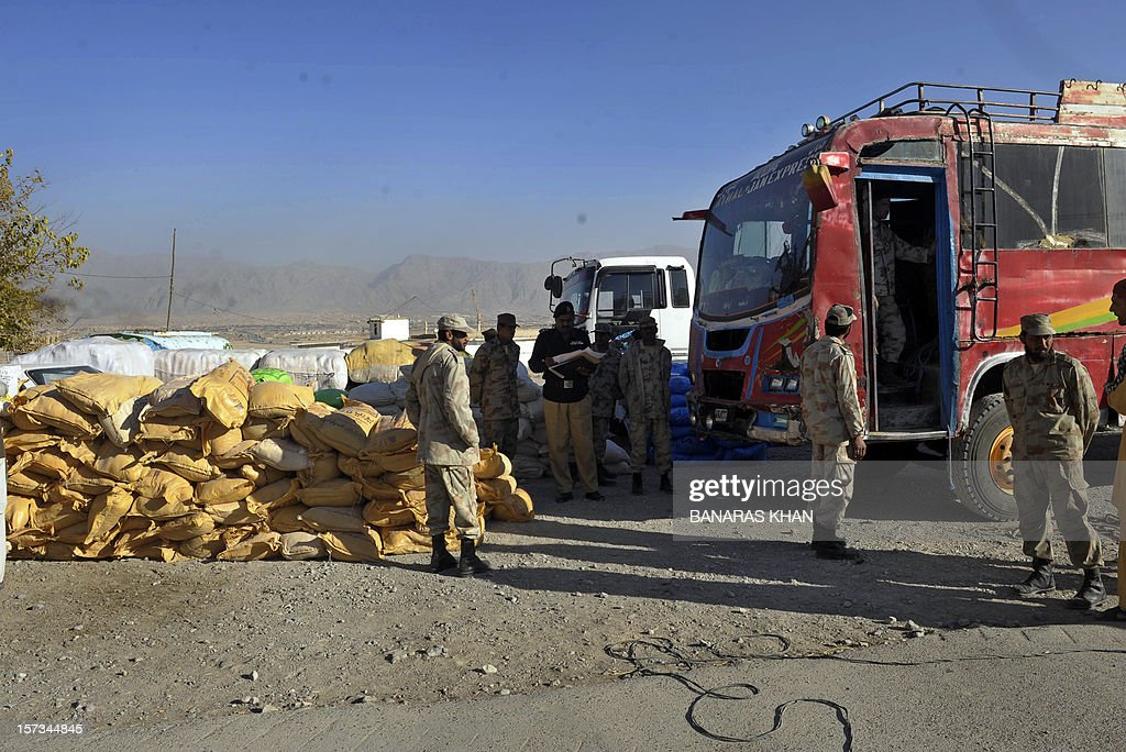 Pakistani paramilitary soldiers stand next to the bags of potassium chlorate which were recovered from a bus in Quetta on December 2, 2012. Pakistani authorities seized nearly 14 tonnes of potassium chlorate, a key ingredient in bomb-making, from a bus in the country's violent and unstable southwest on Sunday, officials said. AFP PHOTO/Banaras KHAN