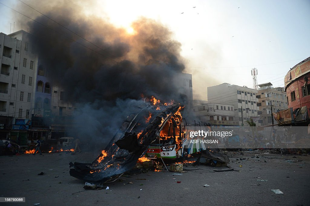 A Pakistani passenger bus burns after an explosion in Karachi on December 29, 2012. At least four people were killed and dozen wounded when a loud explosion ripped apart a passenger bus outside the railway station in the port city of Karachi, the nature of the explosion could not be ascertained. AFP PHOTO/Asif HASSAN