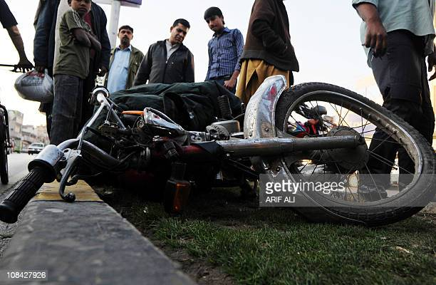 Pakistani peoples look at the motorbike of a commuter who was killed in a shooting by a US consular worker in Lahore on January 27 2011 A US consular...