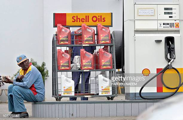 A Pakistani petrol station employee waits for customers at a station in Rawalpindi 24 August 2006 Pakistan State Oil said it has finalized...