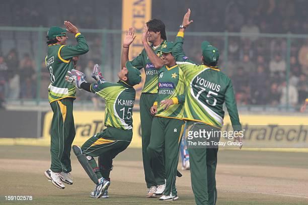 Pakistani players celebrate the dismissal of Gautam Gambhir during the third India Pakistan ODI in New Delhi