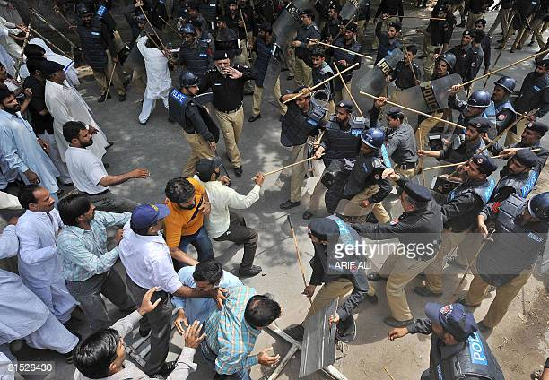 Pakistani police baton charges protesters during a rally in Lahore on June 9 2008 to protest against the government for increasing fuel and food...