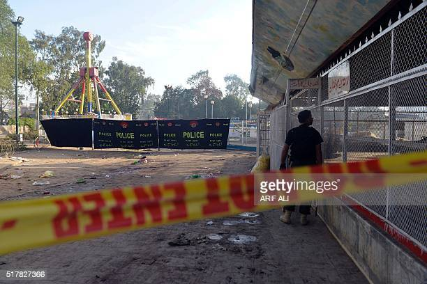 A Pakistani police commando stands guard at the cordonedoff site of the March 27 suicide bombing in Lahore on March 28 2016 The toll from a suicide...