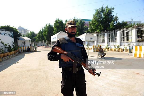 A Pakistani police commando stands guard outside the residence of Pakistan's President Asif Ali Zardari after his arrival from Dubai in Karachi on...