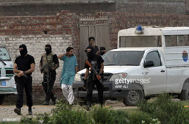 Pakistani police commandos cordon off a house on the outskirts of Lahore on June 29 following a raid on property allegedly used by Taliban militants...