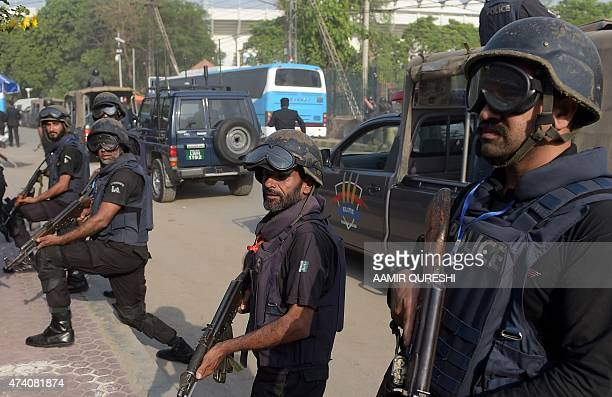 Pakistani police commandos escort a bus carrying Zimbabwe cricketers and team officials as they arrive for net practice at the Gaddafi Cricket...