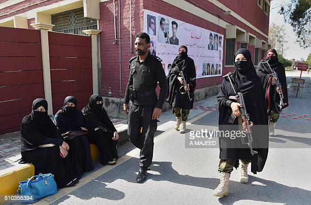 TOPSHOT Pakistani police commandos patrol inside the premises of Bacha Khan university after it was reopened in the northwestern town of Charsadda on...