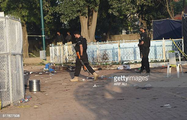 Pakistani police commandos stand guard at the cordonedoff site of the March 27 suicide bombing in Lahore on March 28 2016 The toll from a suicide...