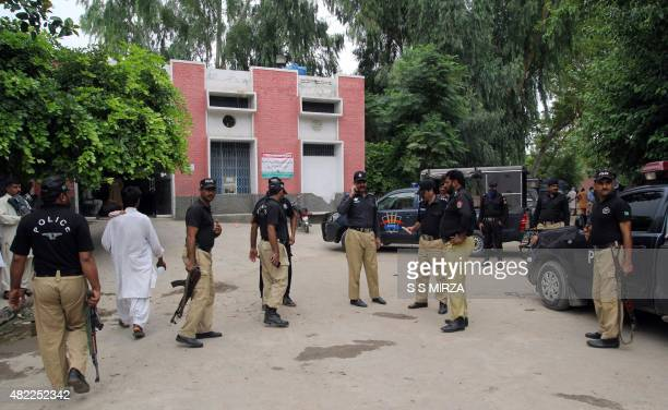 Pakistani police commandos stand outside the hospital where the bodies of Malik Ishaq an antiShiite group leader and other militants have been placed...
