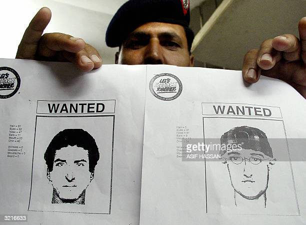 Pakistani police officer shows police artist sketches of unidentified gunmen who opened fire on a police station in this southern Pakistani city in...