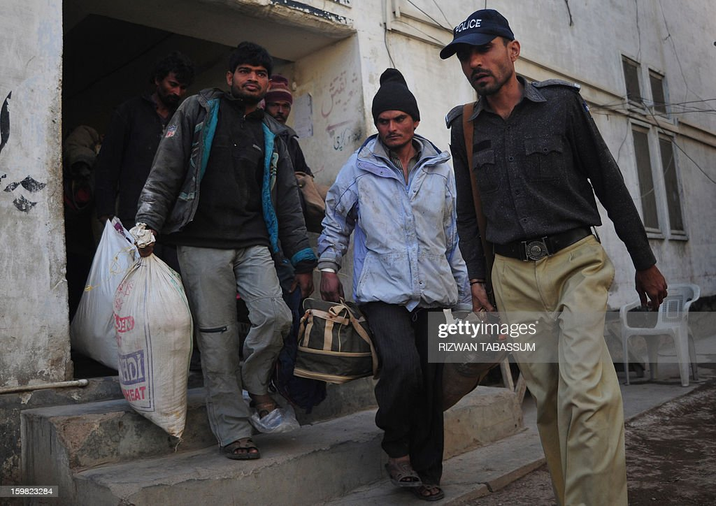 A Pakistani policeman guards Indian fishermen in a police station in Karachi on January 21, 2013. Pakistan has arrested 27 Indian fishermen for illegally straying into its territorial waters, officials said. AFP PHOTO/ Rizwan TABASSUM