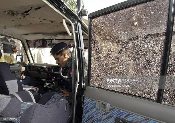 A Pakistani policeman inspects the vehicle of Baluchistan provincial spokesman Raziq Bugti after gunmen shot him dead in Quetta 27 July 2007 Gunmen...