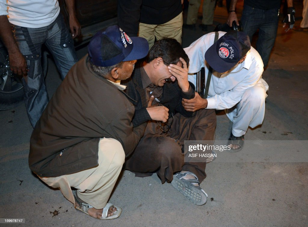 A Pakistani policeman mourns the death of a colleague after the bomb blast in Karachi on January 24, 2013. Two consecutive explosions ripped through Karachi's densely populated Quaidabad area on January 24, killing at least four people and injuring at least seven others. AFP PHOTO/Asif HASSAN