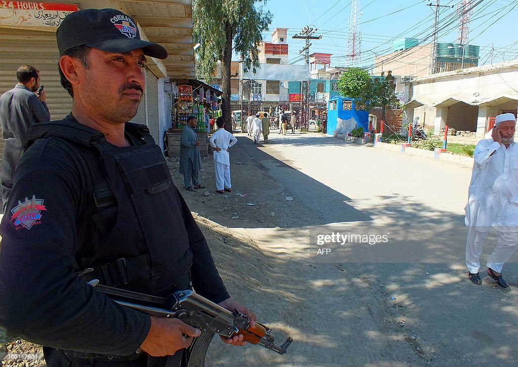 A Pakistani policeman stands guard near a hospital in Bannu on March 31, 2013, where rescuers shifted the injured after a bomb blast at an election rally. A bomb attack claimed by the Taliban near an election rally in restive northwest Pakistan has killed two people and injured six including a candidate, police said. AFP PHOTO/Karim ULLAH