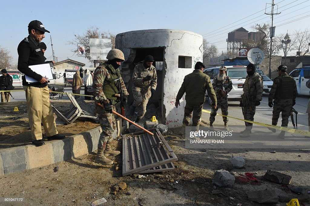 Pakistani policemen and frontier corps investigate the area after a bomb explosion in Quetta on December 12 2015 A frontier corps member was killed...