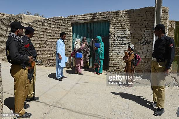 Pakistani policemen escort health workers team during a polio vaccination campaign in Quetta on September 14 2015 Pakistan is one of only three...