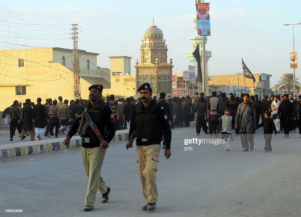 Pakistani policemen guard a Shiite Muslim Ashura procession in the city of Dera Ismail Khan in Khyber Pakhtunkhwa province on November 25, 2012. A bomb attack on a Shiite Muslim procession killed five mourners and wounded more than 80 in northwest Pakistan on November 25 as Shiites marked their holiest day Ashura, officials said.