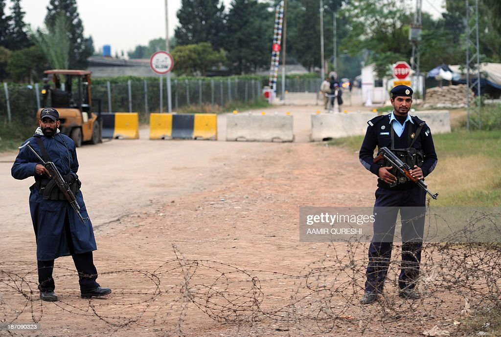 Pakistani policemen stand guard near the residence of former Pakistani military ruler Pervez Musharraf in Islamabad on November 6, 2013. A Pakistan court granted bail to former military ruler Pervez Musharraf over a deadly raid on a radical mosque, bringing closer his possible release after more than six months of house arrest. The ruling by an Islamabad district court means the ex-general is on bail in all the cases brought against him since his return to Pakistan from self-imposed exile, including one relating to the assassination of former prime minister Benazir Bhutto. But the 70-year-old is likely to remain under heavy guard at his villa on the edge of Islamabad, where he has been under house arrest since April, because of serious threats to his life.