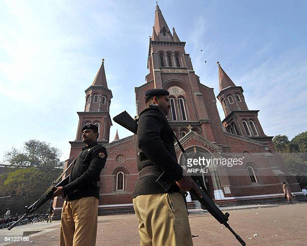 Pakistani policemen stand guard outside a church in Lahore during Christmas on December 25 2008 Pakistan an Islamic nation of 145 million people has...