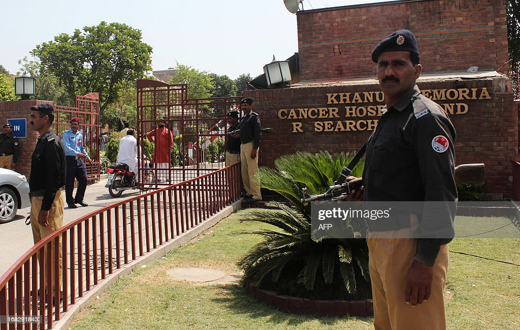 Pakistani policemen stand guard outside the hospital where Pakistani politician and former cricketer Imran Khan is admited in Lahore on May 8, 2013. Khan has been advised to rest for a week after sustaining skull and back injuries in a fall at an election campaign rally, a hospital official said. The former cricket star was admitted to the private Shaukat Khanum hospital that he founded in Lahore on May 7 after falling off a lift taking him to the stage at a rally ahead of Pakistan's general election on Saturday.