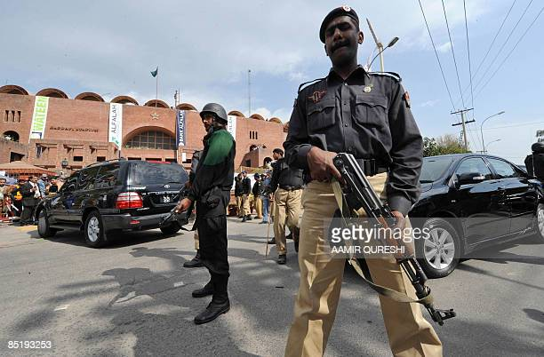 Pakistani policemen stand guard outside The National Stadium after masked gunmen attacked the Sri Lankan cricket team in Lahore on March 3 2009...
