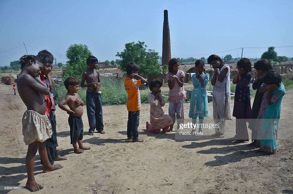 Pakistani poor children prepare to take part in International Children's day in a suburb of Lahore. It's celebrated on June 01 globally. Children's Day is recognized on various days in many places around the world to honor children globally.