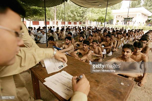 Pakistani potential army officer candidates line up for preliminary medical checks and registration of personal data on June 28 2005 in Rawalpindi...