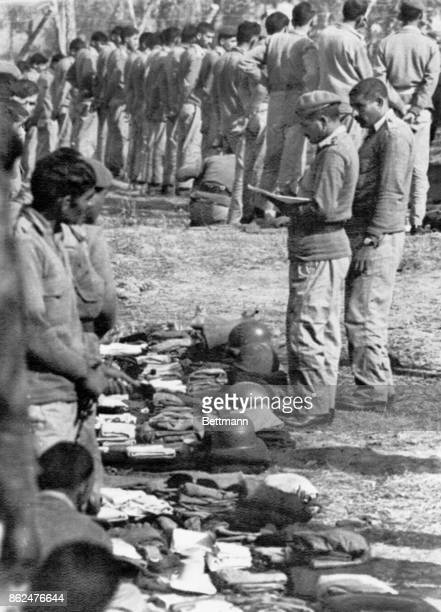 Pakistani POW's are checked by Indian Army officers in a detention camp near Dacca December 27th Indian Army Chief of Staff General SHFJ Mankeshaw...