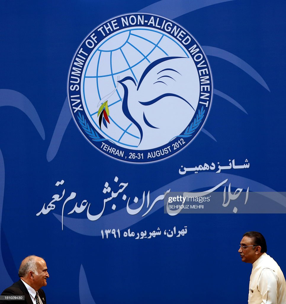 Pakistani President Asif Ali Zardari (R) leaves the podium after his speech as Jordanian Foreign Minister Nasser Judeh (L) attends during the last day of Non-Aligned Movement (NAM) summit in Tehran on August 31, 2012.