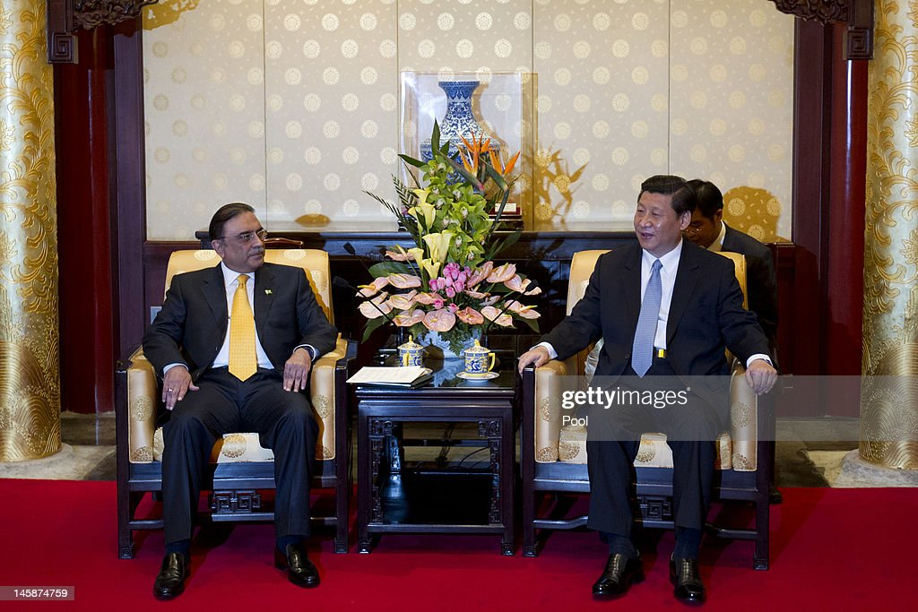 Pakistani President Asif Ali Zardari (L) talks with Chinese Vice President Xi Jinping during their meeting at the Diaoyutai State Guesthouse June 7, 2012 in Beijing, China. Pakistan and China today spoke of investments between the two nations over water conservation and investment.