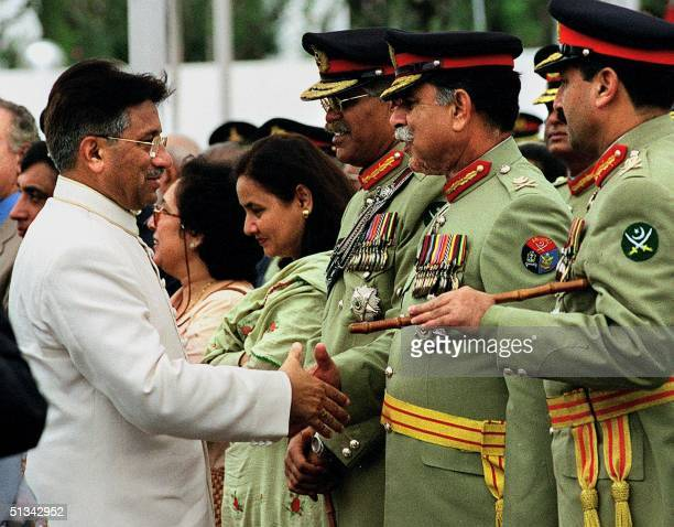 Pakistani President General Pervez Musharraf shakes hand with top military official General Mehmood the chief of Inter Services Intelligence after a...