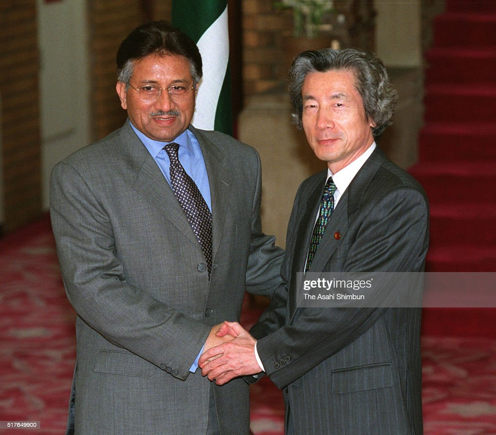 Pakistani President <a gi-track='captionPersonalityLinkClicked' href=/galleries/search?phrase=Pervez+Musharraf&family=editorial&specificpeople=121550 ng-click='$event.stopPropagation()'>Pervez Musharraf</a> and Japanese Prime Minister <a gi-track='captionPersonalityLinkClicked' href=/galleries/search?phrase=Junichiro+Koizumi&family=editorial&specificpeople=171092 ng-click='$event.stopPropagation()'>Junichiro Koizumi</a> shake hands prior to their meeting at Koizumi's official residence on March 14, 2002 in Tokyo, Japan.