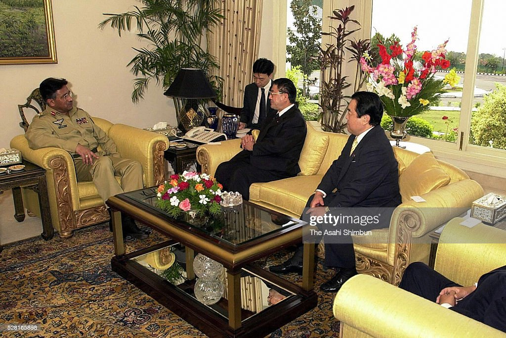 Pakistani President <a gi-track='captionPersonalityLinkClicked' href=/galleries/search?phrase=Pervez+Musharraf&family=editorial&specificpeople=121550 ng-click='$event.stopPropagation()'>Pervez Musharraf</a> (L) meets with Japanese veteran lawmakers Taku Yamazaki, Tetsuzo Fuyushiba and Toshihiro Nikai on November 3, 2001 in Islamabad, Pakistan.