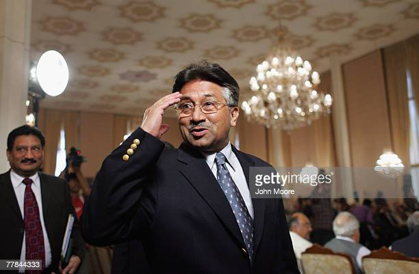 Pakistani President Pervez Musharraf salutes while arriving for a press conference November 11 2007 at the President House in Islamabad Pakistan...