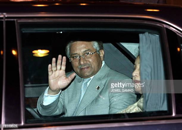Pakistani President Pervez Musharraf waves from a car as First Lady Sehba Musharraf looks on upon their arrival at Halim airport in Jakarta 30...