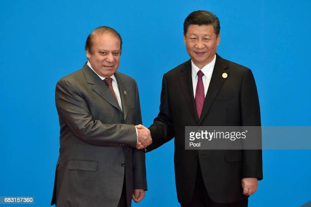 Pakistani Prime Minister Nawaz Sharif shakes hands with Chinese President Xi Jinping during the welcome ceremony for the Belt and Road Forum at the...
