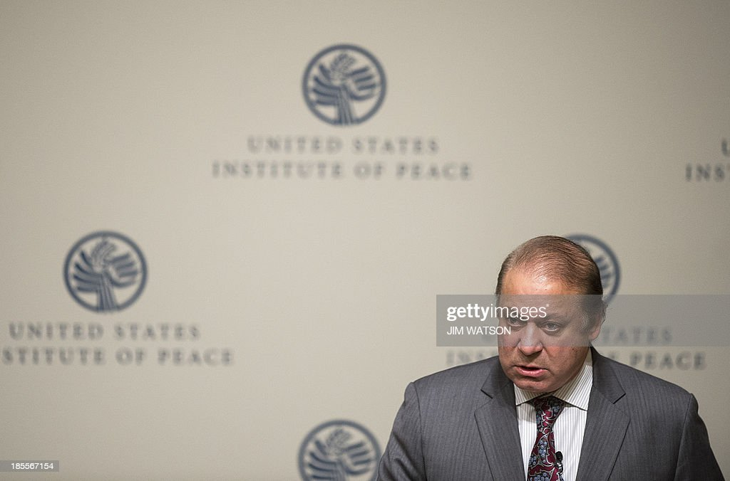 Pakistani Prime Minister Nawaz Sharif speaks at the US Institute of Peace in Washington, DC, October 22, 2013. Sharif vowed Tuesday to go the 'extra mile' to make peace with India, saying the historic rivals can resolve all issues through dialogue. Sharif, addressing the US Institute of Peace in Washington, said that Pakistan 'will not be found wanting in walking the extra mile' with India. AFP PHOTO / Jim WATSON