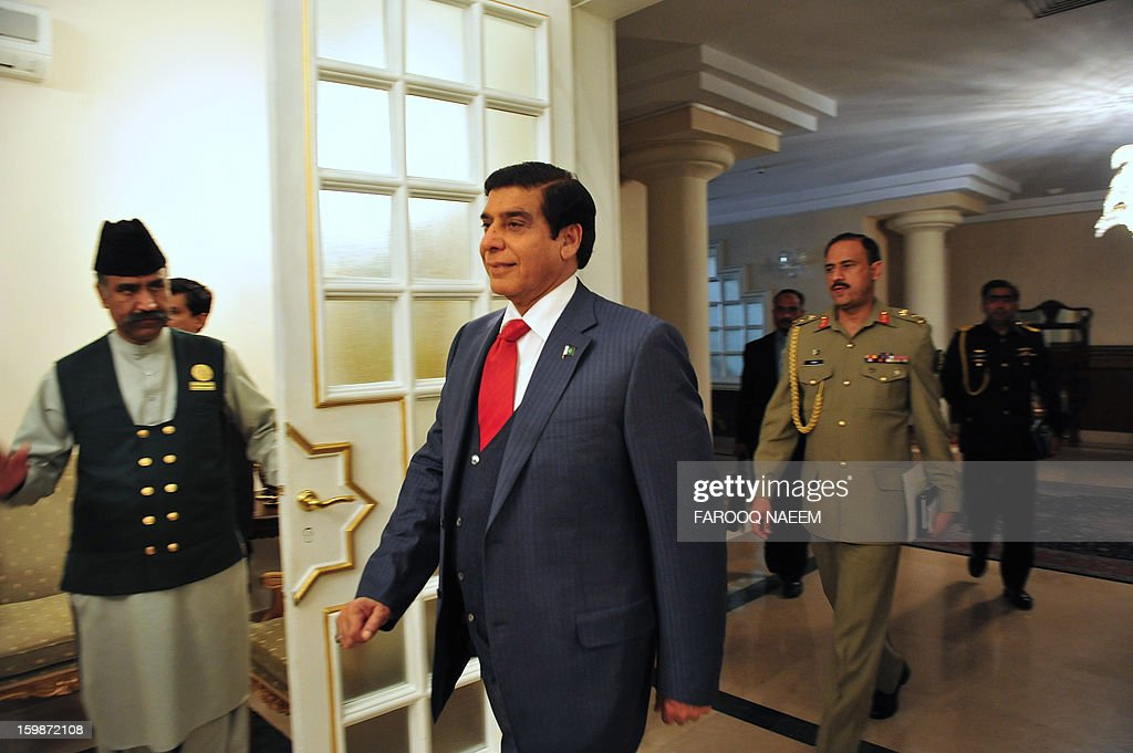 Pakistani Prime Minister Raja Pervez Ashraf (C) arrives for talks with a British delegation led by Secretary of State for International Development Justine Greening (unseen) during a meeting in Islamabad on January 22, 2013. Greening arrived in Islamabad to meet Pakistani leaders of mutual interest. AFP PHOTO/ Farooq NAEEM
